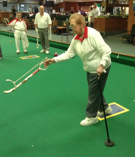 contact us - Using bowls arm and ferruled walking stick